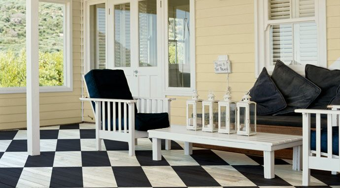 The checkerboard porch floor was created with Benjamin Moore's hale navy (HC-154) and mountain peak white (OC-121).