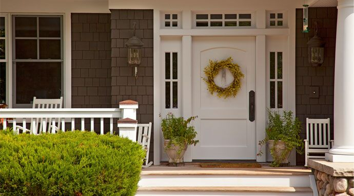 Benjamin Moore's sophisticated white opulence (OC-69) paint color beautifully envelops this front door.