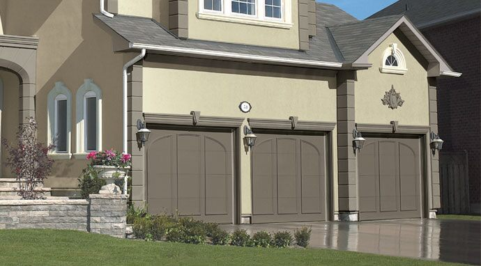 Benjamin Moore's paint color dolphin (AF-715) gives these garage doors a sophisticated look.