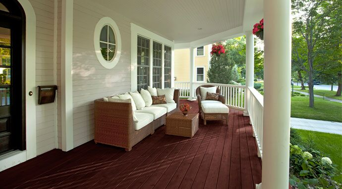 Benjamin Moore's hodley red (HC-65) paint color on this porch floor creates a lasting impression.