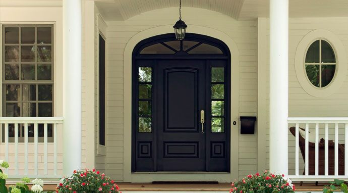 A front door painted with Benjamin Moore's baby seal black (2119-30) instantly catches the eye.