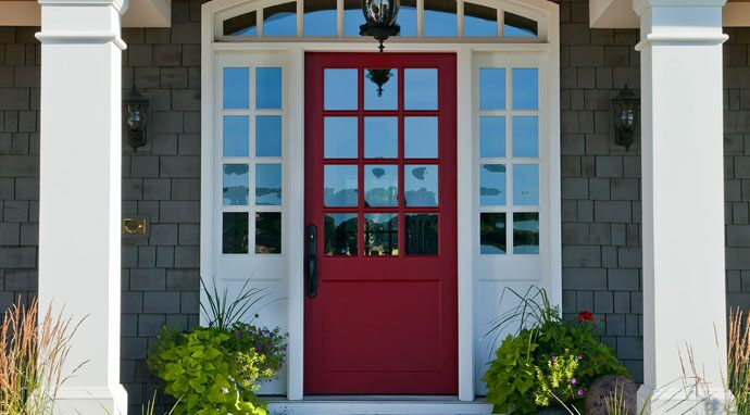 Benjamin Moore's pomegranate (AF-295) paint color on this front door creates a vivid first impression.