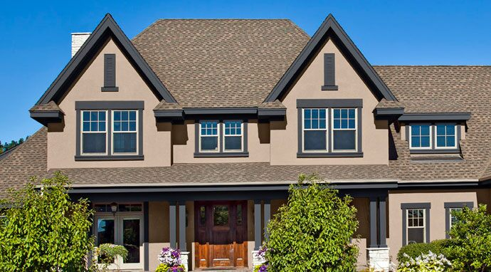 Trim painted in Benjamin Moore's wolf gray (2127-40) highlights this home's exterior characteristics.