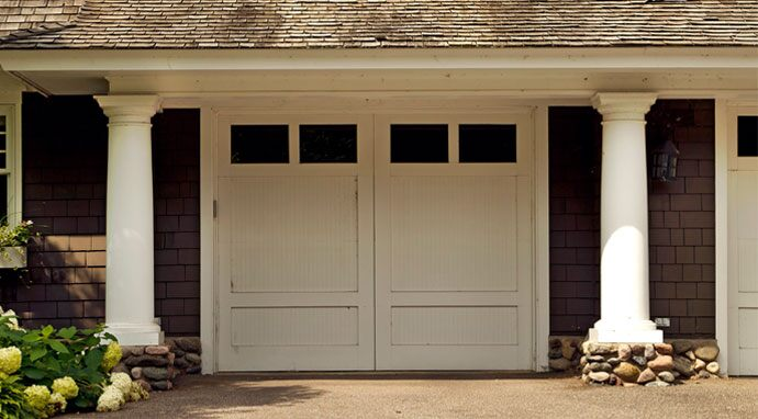 Using Benjamin Moore's frostine (AF-5) on the garage doors enhances this home's two-tone color scheme.