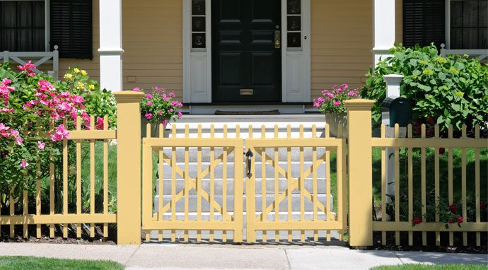 Benjamin Moore's straw (2154-50) paint color on this fence blends well with white trim.
