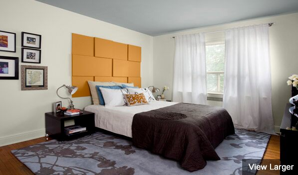 Bedroom featuring a painted canvas headboard.