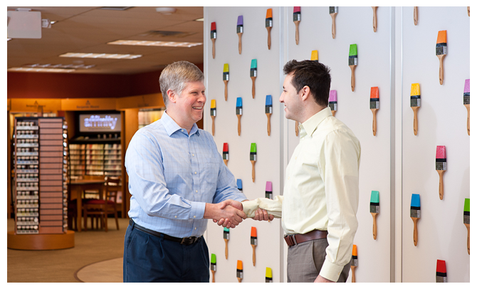 Two men shake hands while enjoying careers at Benjamin Moore.
