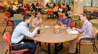 Employees enjoying lunch in the Benjamin Moore cafe.